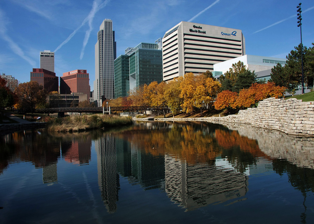 Omaha reflections at the Gene Leahy mall.<br /> (11-1-08)<br /> <br /> Another beautiful fall day in Omaha. I wish we could have days like this every day, but I know Winter is just around the corner, and this lagoon will soon be frozen.